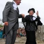 Master of Ceremonies dances with a Widow