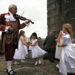 The Fiddler plays the violin for the dancers