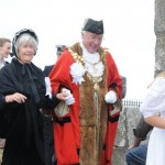 The Mayor dances with one of the Widows