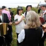 Musicians play on the way to the Knill Steeple