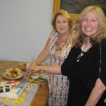 Mayor Linda Taylor and President Karyn Phillipsen cut the cake