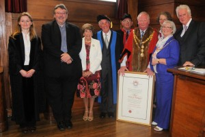 Pictured (left to right) are Louise Dowe (Town Clerk) Andrew Mitchell (proposer) Catherine Tonkin, Terry Tonkin (Honorary Freeman), Alan Major (Sergeant at Mace), Colin Nicholls (Mayor) Tamsyn Williams (Deputy Mayor), Denise Nicholls (Mayoress) and former town councillor Bill Fry (seconder)