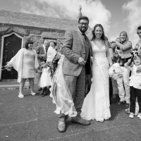 The wedding party outside the island Chapel