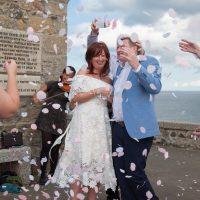 Throwing confetti at a wedding at St Nicholas Chapel